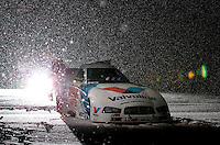 Dec. 3, 2013; Brownsburg, IN, USA; Snow falls during a portrait of the car of NHRA funny car driver Jack Beckman at Don Schumacher Racing.