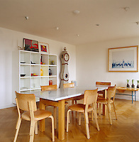 In the dining room the marble-topped table is a one-off design by Thomas Sandell and the chairs are by Alvar Aalto