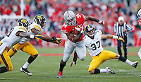 Ohio State Buckeyes running back Carlos Hyde (34 slips by Iowa defenders on his way to a fourth quarter TD  at Ohio Stadium on October 19, 2013.  (Chris Russell/Dispatch Photo)