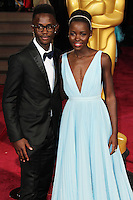 HOLLYWOOD, LOS ANGELES, CA, USA - MARCH 02: Peter Nyong'o Jr, Lupita Nyong'o at the 86th Annual Academy Awards held at Dolby Theatre on March 2, 2014 in Hollywood, Los Angeles, California, United States. (Photo by Xavier Collin/Celebrity Monitor)