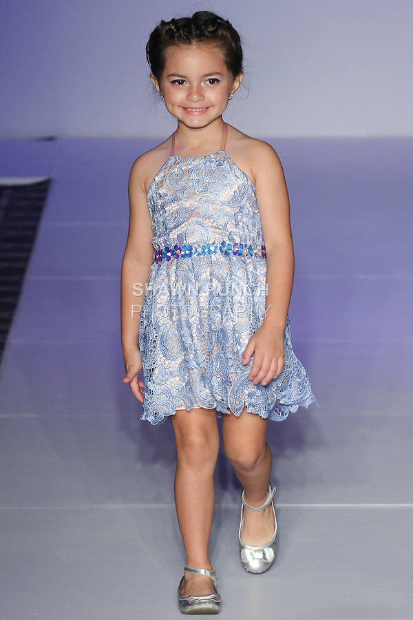 Child model walks runway with an outfit from the Michelle Ann Spring Summer 2016 collection, for the Designer's Collective fashion show, at Fashion Gallery NYFW Spring Summer 2016 show, during New York Fashion Week.