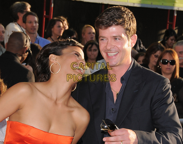 PAULA PATTON & ROBIN THICKE .The Touchstone Pictures' World Premiere of Swing Vote held at The El CapitanTheatre in Hollywood, California, USA. .July 24th, 2008  .half length orange strapless gold hoop earrings black suit jacket laughing married husband wife .CAP/DVS.©Debbie VanStory/Capital Pictures.