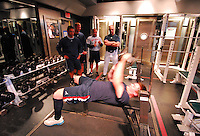 March 18, 2007: Atlanta Braves strength and conditioning coach Phil Falco, rear at right,  works with a player during Spring Training in 2007. Falco, a roving instructor with the Braves organization at that time, was named strength and conditioning coach for the Atlanta parent club in June 2008.