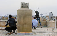 Photographer: Rick Findler/Borderline News..18.01.13 Members of the Free Syrian Army get onto a roof top to attack a group of President Assad's forces with gun-fire and a home-made explosive device in the heart of Aleppo