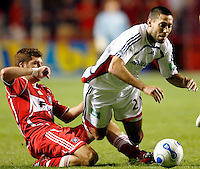 Chicago Fire defender Gonzalo Segares (25) slide tackles the ball away from New England Revolution midfielder Clint Dempsey (2).  The Chicago Fire defeated the New England Revolution 2-1 in the quarterfinals of the U.S. Open Cup at Toyota Park in Bridgeview, IL on August 23, 2006...