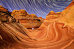 Night time exposure of person exploring The Wave in the Coyote Buttes North special permit area of the Vermillion Cliffs wilderness area on the border with Utah and Arizona. This amazing, unique and fragile landscape is remote and heavily regulated