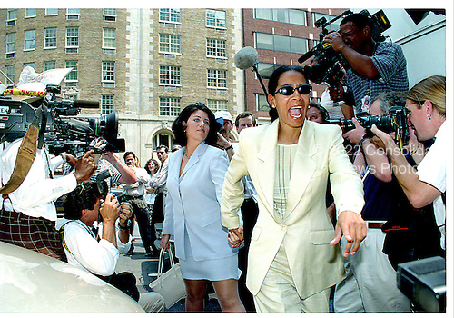 Washington, DC - July 28, 1998 -- Monica Lewinsky follows Judy Smith through a hoarde of media to her lawyer's office in Washington, DC on July 28, 1998..Credit: Ron Sachs / CNP