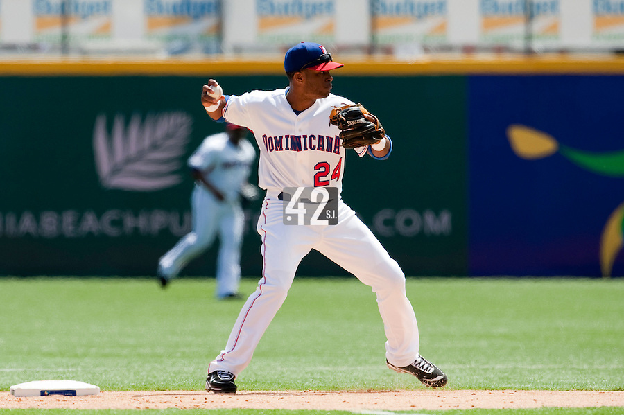 7 March 2009: #24 Robinson Cano of the Dominican Republic throws the ball to first base during the 2009 World Baseball Classic Pool D match at Hiram Bithorn Stadium in San Juan, Puerto Rico. Netherlands pulled off a huge upset in their World Baseball Classic opener with a 3-2 victory over Dominican Republic.