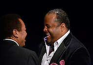 January 26, 2012  (Washington, DC)  TV One commentator and CNN contributor Roland Martin (right) shares a laugh with Johnathan Rodgers (left) at the 2012 National Association of Black Journalists (NABJ) Hall of Fame Induction Ceremony. Rodgers was inducted during a ceremony held at the Newseum in Washington.  (Photo by Don Baxter/Media Images International)