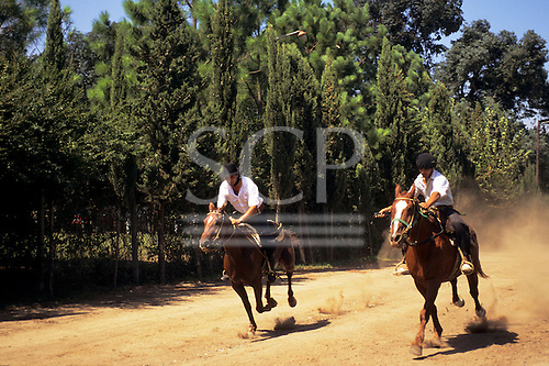 Argentina. Gauchos in a display of horseback skills; Estancia Argentino, near Buenos Aires.