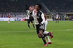 Juan Cuadrado of Juventus appears to receive an arm in the face from Ante Rebic of AC Milan, appeals for a foul were waved away by referee Paolo Valeri during the Coppa Italia match at Giuseppe Meazza, Milan. Picture date: 13th February 2020. Picture credit should read: Jonathan Moscrop/Sportimage