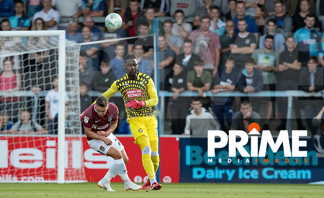 Goalkeeper Yves Ma-Kalambay of Wycombe Wanderers clears from Billy Waters of Northampton Town during the Carabao Cup match between Wycombe Wanderers and Northampton Town at Adams Park, High Wycombe, England on 14 August 2018. Photo by Andy Rowland.