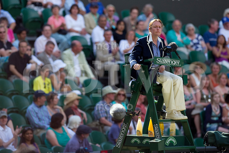 The umpire The Final of the Mixed Doubles Leander Paes (IND) and Cara Black (ZIM) plays against Wesley Moodie (RSA) and Lisa Raymond (USA)  on Centre Court. The Wimbledon Championships 2010 The All England Lawn Tennis & Croquet Club  Day 13 Sunday 04/07/2010