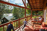 USA, Alaska, Redoubt Bay, Big River Lake, hanging out on the patio of one of the cabins at Redoubt Bay Lodge