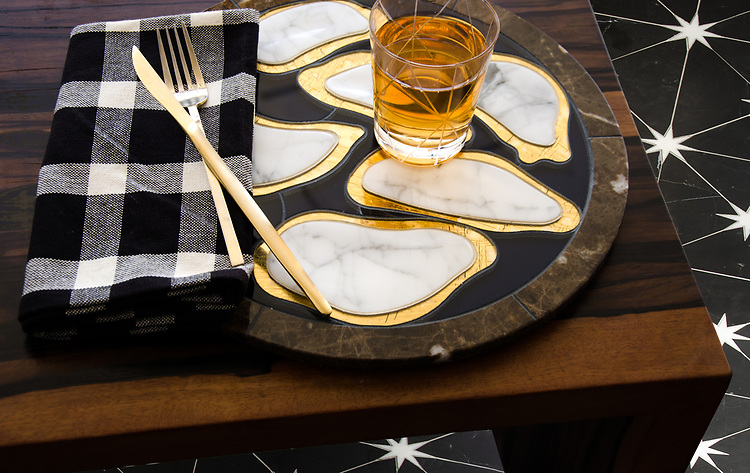 Custom Oyster plate, a waterjet stone and glass mosaic, shown in Emperador Dark, Calcatta, 24K gold glass, and Deep Ultra Marine Serenity Glass. <br />