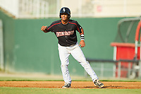 Cleuluis Rondon (13) of the Kannapolis Intimidators takes his lead off of first base against the Rome Braves at CMC-Northeast Stadium on August 25, 2013 in Kannapolis, North Carolina.  The Intimidators defeated the Braves 9-0.  (Brian Westerholt/Four Seam Images)