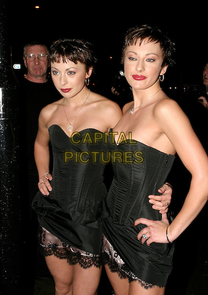 CHEEKY GIRLS - MONICA & GABRIELLE.Ginger - bar launch party, Sloane Street, London..October 12th, 2005.Gabriella half length black strapless dress twins sisters siblings red lipstick.www.capitalpictures.com.sales@capitalpictures.com.© Capital Pictures.