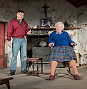 """London, UK. 22/07/2011. """"The Beauty Queen of Leenane"""" by Martin McDonaugh returns to the Young Vic. Johnny Ward as Ray Dooley and Rosaleen Linehan as Mag Folan. Photo credit: Jane Hobson"""