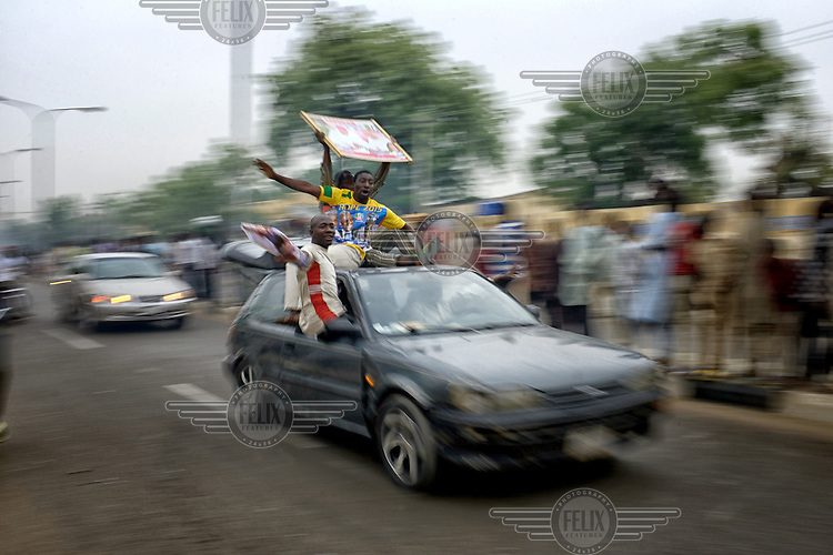 Jubilant youths parade in their cars through the city centre as people come out to celebrate the victory of Muhammadu Buhari, leader of the APC (All Progressives Congress Party), in the 2015 Nigerian Presidential elections.