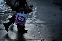 A woman carries flowers during Valentine's Day in New York, Feb 14, 2014. VIEWpress/Eduardo Munoz Alvarez
