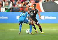 Lionard Pajoy (26) of D.C. United goes against Raymon Gaddis (28) of the Philadelphia Union. The Philadelphia Union defeated D.C. United 3-2, at RFK Stadium, Sunday April 21, 2013.