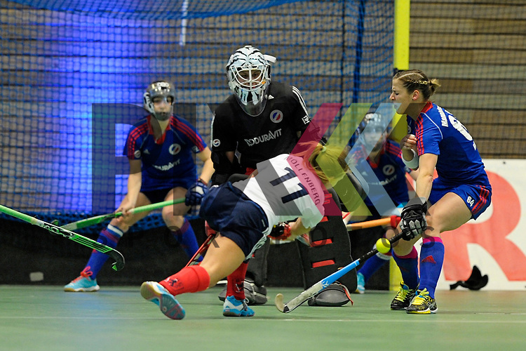 GER - Luebeck, Germany, February 07: During the 1. Bundesliga Damen indoor hockey final match at the Final 4 between Mannheimer HC (blue) and Duesseldorfer HC (white) on February 7, 2016 at Hansehalle Luebeck in Luebeck, Germany.   Nadine Stelter #13 of Mannheimer HC saves a shot from Darja Moellenberg #11 of Duesseldorfer HC