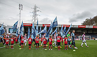 The Teams head onto the field during the Sky Bet League 2 match between Wycombe Wanderers and Barnet at Adams Park, High Wycombe, England on 16 April 2016. Photo by Andy Rowland.