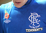 Close up of the detail on the Rangers home shirt of Barrie McKay