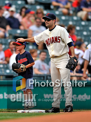 14 September 2008: Cleveland Indians' infielder Jamey Carroll welcomes a Little Leaguer during pre-game introductions prior to a game against the Kansas City Royals at Progressive Field in Cleveland, Ohio. The Royal defeated the Indians 13-3 to take the 4-game series three games to one...Mandatory Photo Credit: Ed Wolfstein Photo