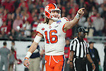 Clemson Tigers quarterback Trevor Lawrence (16) points to the crowd after a touchdown during the Fiesta Bowl game against the Ohio State Buckeyes on Saturday, Dec 28, 2019 in Glendale, Ariz.  (Gene Lower via AP)