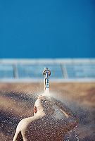 A man taking a shower on the beach at Cape Town, South Africa