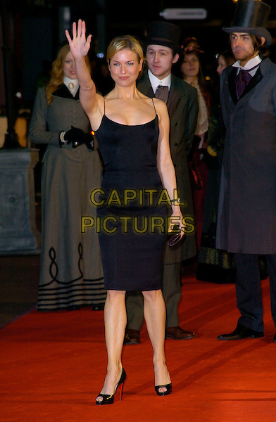 "RENEE ZELLWEGER.""Miss Potter"" World Film Premiere.Empire cinema, Leicester Square.London, England  3rd December 2006.full length waving black dress hand open toe Christian Louboutin shoes.CAP/CAN .©Can Nguyen/Capital Pictures"