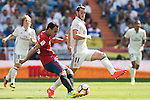 Gareth Bale of Real Madrid battles for the ball with Unai Garcia of Osasuna during the La Liga match between Real Madrid and Osasuna at the Santiago Bernabeu Stadium on 10 September 2016 in Madrid, Spain. Photo by Diego Gonzalez Souto / Power Sport Images