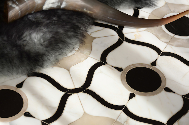 Wesley Petite, a waterjet mosaic shown in polished White Onyx, Calacatta and Nero Marquina, is part of the Aurora® collection by New Ravenna.