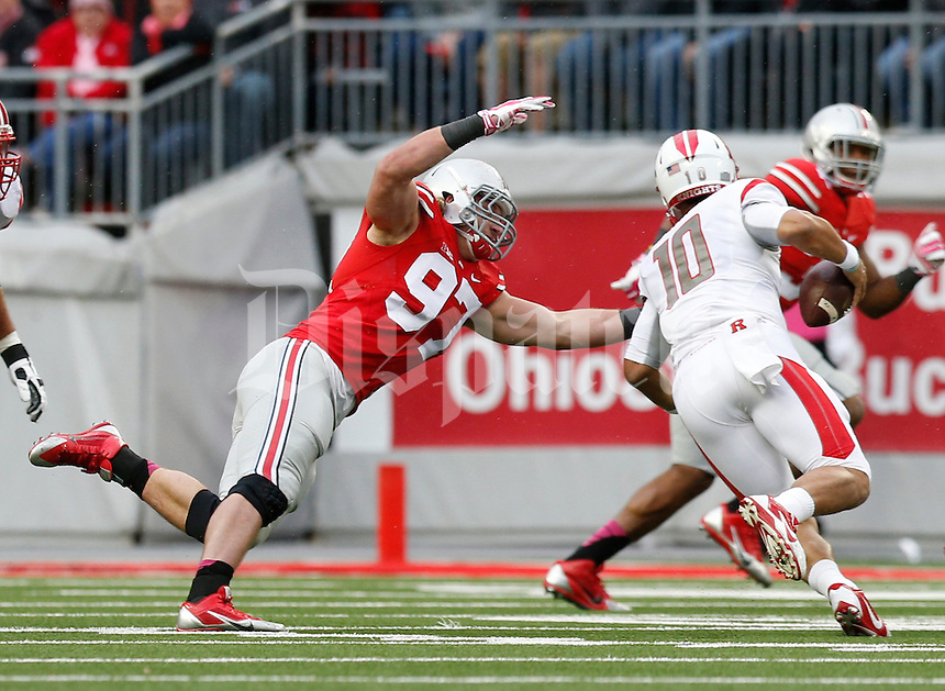 Ohio State Buckeyes defensive lineman Joey Bosa (97) sacks Rutgers Scarlet Knights quarterback Gary Nova (10) during the second quarter of the NCAA football game at Ohio Stadium in Columbus on Oct. 18, 2014. (Adam Cairns / The Columbus Dispatch)