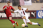 20 March 2008: Charlie Davies (USA) (9) slips down, defended by Nikolas Ledgerwood (CAN) (6). The United States U-23 Men's National Team defeated the Canada U-23 Men's National Team 3-0 at LP Field in Nashville,TN in a semifinal game during the 2008 CONCACAF Men's Olympic Qualifying Tournament. With the victory, the United States qualified for the 2008 Beijing Olympics.