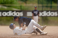 23 May 2009: Romain Martinez-Scott of Savigny falls over Matthieu Brelle Andrade of Senart during the 2009 challenge de France, a tournament with the best French baseball teams - all eight elite league clubs - to determine a spot in the European Cup next year, at Montpellier, France. Savigny wins 4-1 over Senart.
