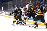 March 25,  2011             Second period action between (from left): Colorado College forward Nick Dineen (22), Boston College forward Chris Kreider (19), Boston College forward Pat Mullane (11), Colorado College defenseman Gabe Guentzel (10), and Colorado College left wing Tim Hall (23). The Boston College Eagles played against the Colorado College Tigers in the second semifinal of the NCAA Division 1 Men's West Regional Hockey Tournament, on Friday March 25, 2011 at the Scottrade Center in downtown St. Louis.
