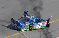 Apr 26, 2009; Talladega, AL, USA; NASCAR Sprint Cup Series driver Carl Edwards (99) climbs from his car after crashing on the last lap during the Aarons 499 at Talladega Superspeedway. Mandatory Credit: Mark J. Rebilas-