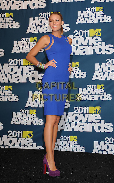 Blake Lively.in the Press Room at the 2011 MTV Movie Awards at Universal Studios' Gibson Amphitheatre in Universal City, California, USA, June 5th 2011.  .pressroom full length blue dress side hand on hip purple suede shoes christian louboutin cut out .CAP/ROT/TM.©TM/Roth Stock/Capital Pictures