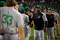 Clinton LumberKings Frank Moore (26) high fives players after a Midwest League game against the Great Lakes Loons on July 19, 2019 at Dow Diamond in Midland, Michigan.  Clinton defeated Great Lakes 3-2.  (Mike Janes/Four Seam Images)
