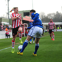 Lincoln City's Danny Rowe battles with Macclesfield Town's Michael Rose<br /> <br /> Photographer Andrew Vaughan/CameraSport<br /> <br /> The EFL Sky Bet League Two - Lincoln City v Macclesfield Town - Saturday 30th March 2019 - Sincil Bank - Lincoln<br /> <br /> World Copyright © 2019 CameraSport. All rights reserved. 43 Linden Ave. Countesthorpe. Leicester. England. LE8 5PG - Tel: +44 (0) 116 277 4147 - admin@camerasport.com - www.camerasport.com