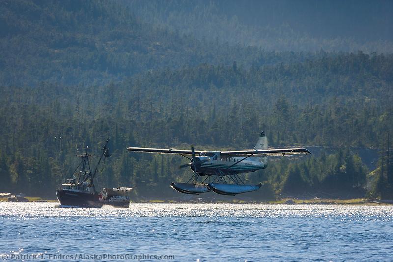 Flightseeing float plane lands in the Tongass Narrows, Ketchikan, Alaska.