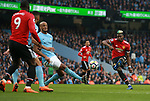 Paul Pogba of Manchester United takes a shot during the premier league match at the Etihad Stadium, Manchester. Picture date 7th April 2018. Picture credit should read: Simon Bellis/Sportimage