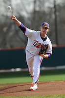 Starting Pitcher Kevin Brady #19 of the Clemson Tigers delivers a pitch during a game against the North Carolina Tar Heels at Doug Kingsmore Stadium on March 9, 2012 in Clemson, South Carolina. The Tar Heels defeated the Tigers 4-3. Tony Farlow/Four Seam Images.