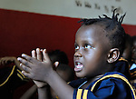 A girl sings a song during class in a day care center in Monrovia, Liberia, sponsored by United Methodist Women.