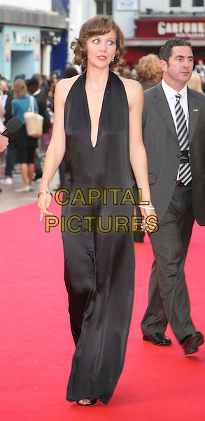 """MAGGIE GYLLENHAAL .Arrivals at the UK Premiere of the new Batman movie """"The Dark Knight"""", Odeon Leicester Square, London, England, .July 21st 2008. .full length black Stella McCartney catsuit silk pantsuit plunging neckline low cut halterneck open toe shoes.CAP/DS.©Dudley Smith/Capital Pictures"""