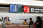 TOKYO - JANUARY 09: A passenger checks in at a counter of Asia's largest air carrier, Japan Airlines (JAL), at Haneda Airport (HND) on January 9, 2010 in Tokyo, Japan. (Photo by Laurent Benchana/Nippon News)