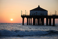Sunset and waves on Manhattan Beach Pier, California