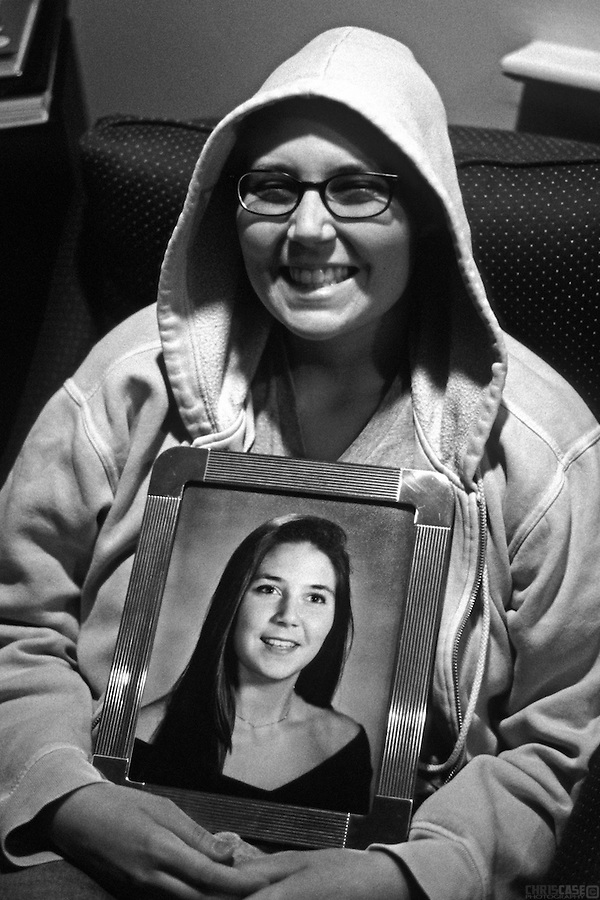 Always a fan of hooded sweatshirts, Karin became ever fonder of their protective qualities after losing her hair. She holds her high school graduation photo.<br /> <br /> &quot;Our minds were rarely sad. We strongly believed and often reminded one another that sadness did not fight cancer. Perhaps the best reminder to both of us and to everyone that was affected by the situation, were our frequent displays of silliness, our capacity for normal behavior under abnormal circumstances.&quot; - Karin Weidenhammer